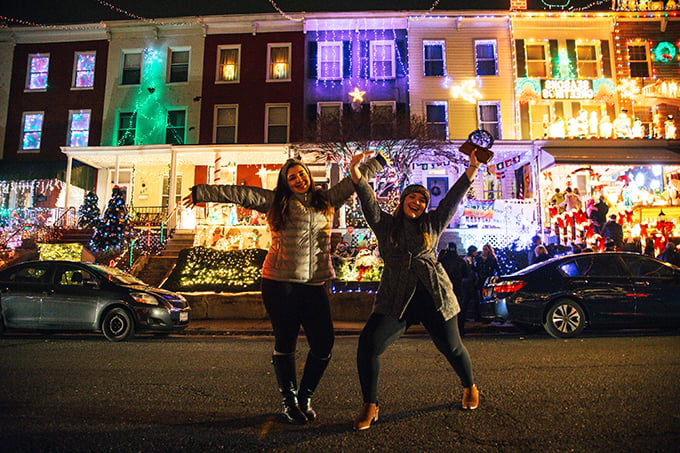 Students posing at Miracle on 34th Street Lights