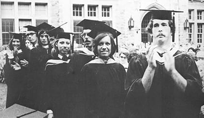 An old black and white photo of male and female students at commencement