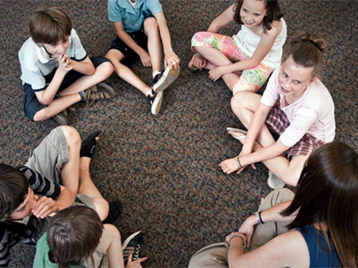 Children on the floor in a circle