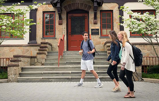 Three students walking in front of the Humanities building